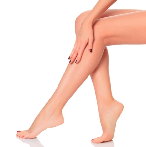 Well-groomed female legs after depilation procedure. A day at a spa concept. Isolated on white background.