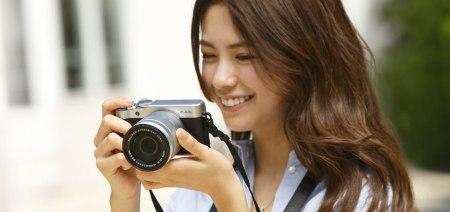 Woman taking photo with Fuji X-A10