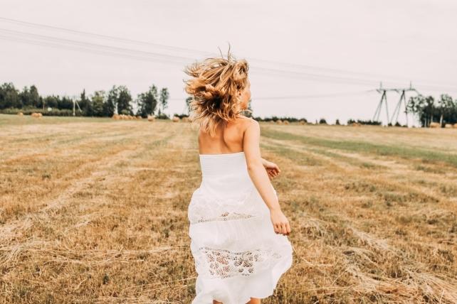 Running through a field in Summer