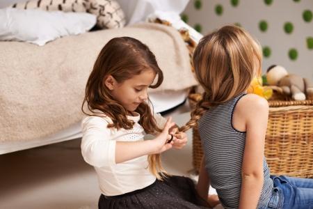 Little girls braiding hair